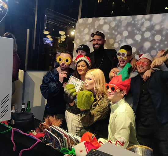 Photo Booth at a corporate party where people wear hilarious props