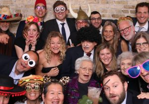 People having fun with props in a photo booth at a Chicago Wedding